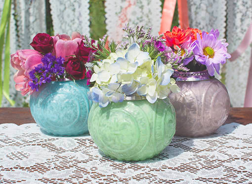 Our collections of pastel mercury glass candle holders and vases are available in three delightful tones: mint, pale pink, and soft blue. All items sold separately.