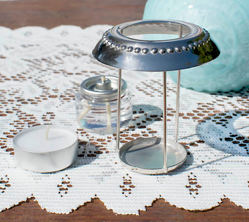 The beaded metal candle caddy permits you easy access for candle placement, and decoratively protects the rim of the glass vase.