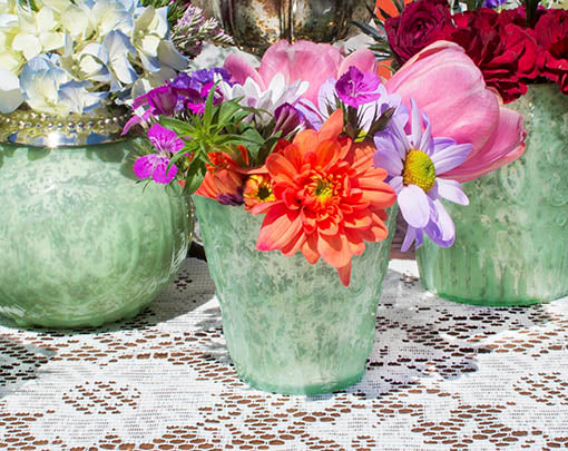 Mix and match with other mint mercury glass pieces on a table to add variety to your decor.
