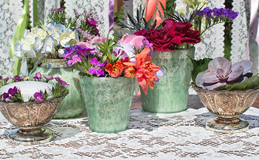 Arrange into color popping table decor with other mercury glass vases and bowls.