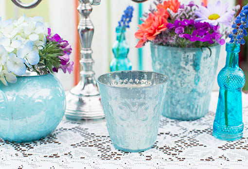 Set your scene using our full collection of pastel blue mercury glass vessels coordinated with additional glass decor in blue.