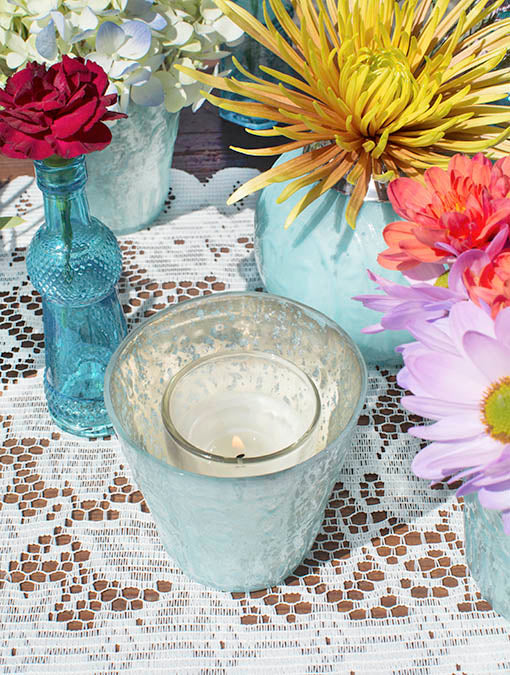Drip-free, real wax votives in clear glass are the perfect pairing for your pastel mercury glass candle holders.