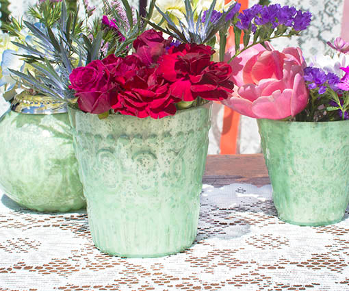 Dress our mint candle holders with colorful blooms and capture the spirit of Spring.