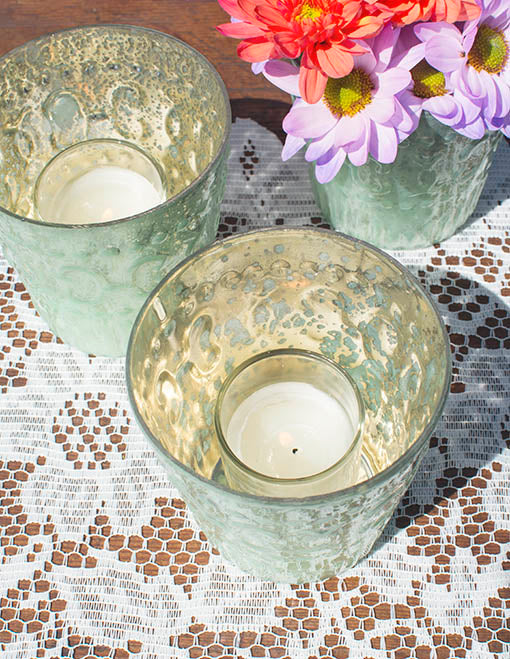 Any of our votive candles work beautifully with these delicate vessels.