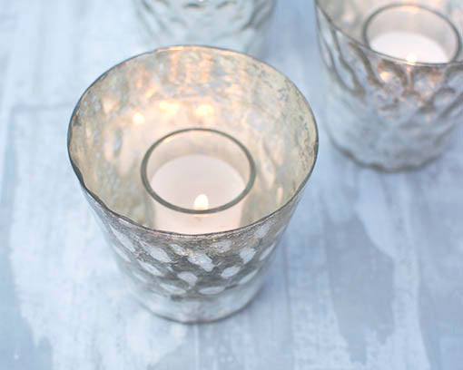 Select any style of votive, like the wax-filled glass votives shown here, or select one of our flameless votives.