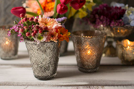 Use our beaded mercury glass votive candle holders to beautifully accentuate your candle light, or use them to accent with jewel-tone florals. For a romantic, luxurious setting, pair with our gold tone mercury glass accessories.