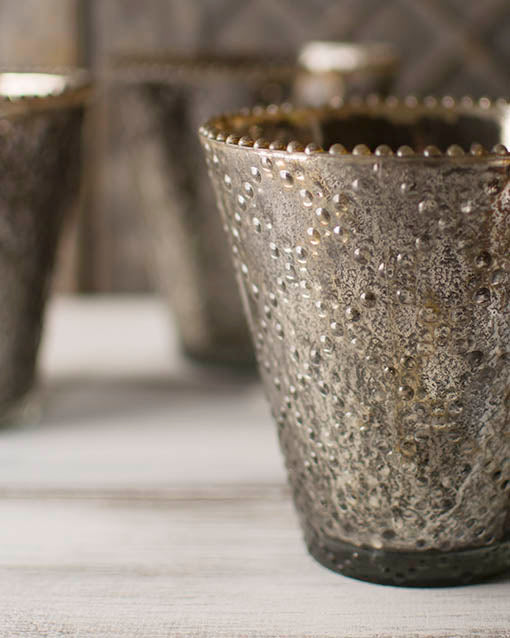 Our pewter mercury glass vases are textured with a criss cross beaded pattern, offering visual interest to your table top and floral displays.