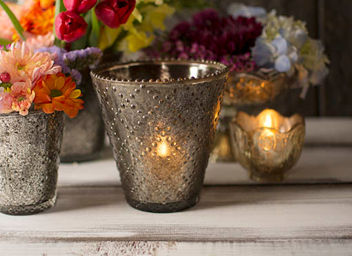 Beautifully project your candle light, or accent rich jewel-tone flowers using our pewter tone beaded glass vases. To create a luxurious setting, combine them with our gold tone mercury glass decor accessories.