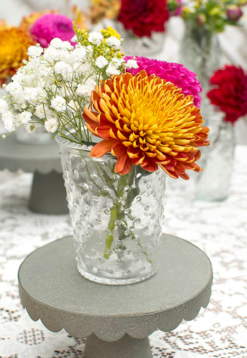Add rustic accents to this vase by standing it on our galvanized metal cake stand.