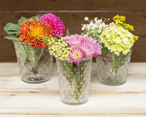 Pair this vase with the large and small hobnail vases for a complete vintage centerpiece set.