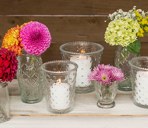 Use this set as candle holders alongside our other clear glass decor for a romantic vintage chic wedding.