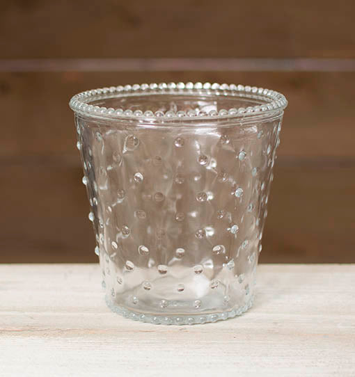 This clear glass vase is accented with a hobnail pattern and trim for a vintage styled centerpiece.
