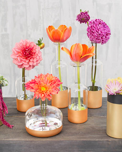 Complete the look with our full collection of gold dipped clear bud vases.