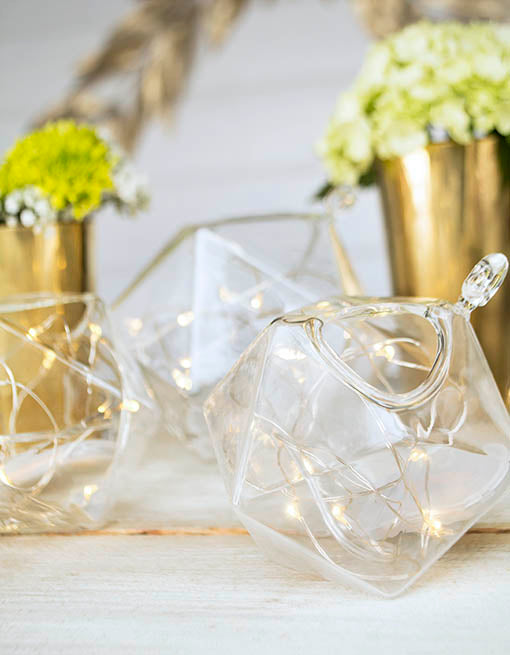 Use short strands of fairy moon lights to add even more sparkle to your terrarium arrangement!