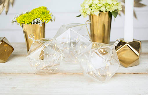 Tuck fairy moon lights inside each terraria and nest among golden geometric candle holders to set a magical table!