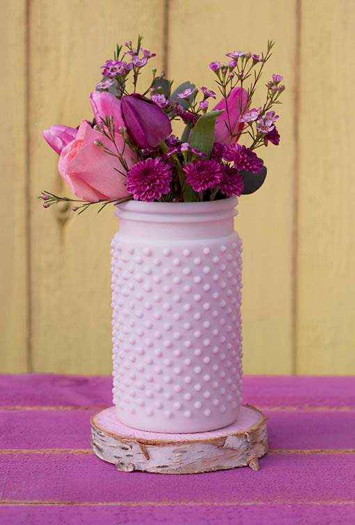 Our hobnail vase is the pretty in pink stunner perfect for gardenscape weddings and quaint luncheons.