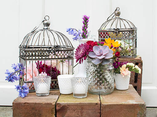Integrate beautiful arrangements in your home or event by combining our clear hobnail candle holders with other hobnail decor, birdcages, and bright flowers for a garden fresh look.