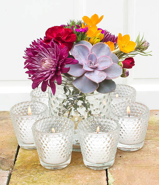 Arrange a tasteful yet playful candlelit centerpiece, surrounding clear hobnail jars with our small votive candle holders. Items sold separately.