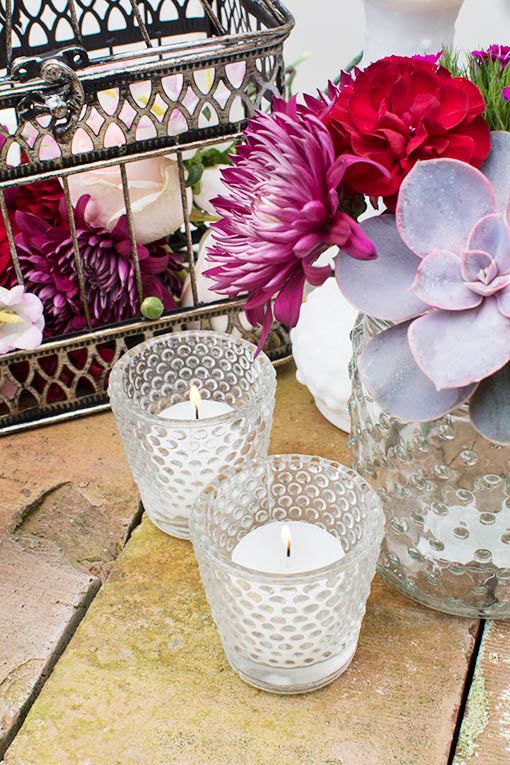 Choose tea lights or votive candles to enliven our clear hobnail candle holders. Candles sold separately.