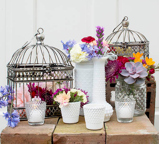 Enrich your garden parties with our milky white hobnail candle holders paired with floral arrangements, bird cages, and other hobnail decor.