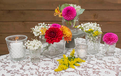 Fill your tablescapes with our clear glass decor and lace tablecloth for a vintage inspired centerpiece.
