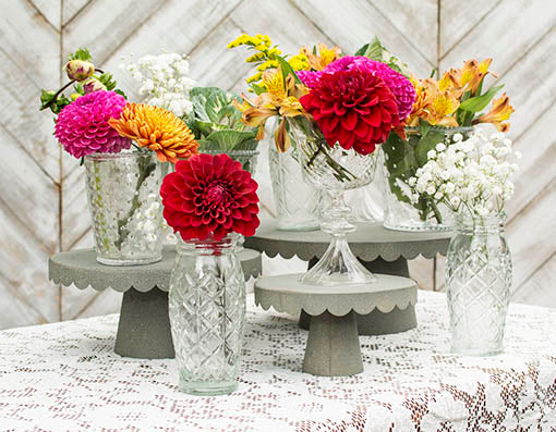 Embellish your table with our clear glass collection and metal cake trays for unique vintage style! Add our lace tablecloth to complete the look.