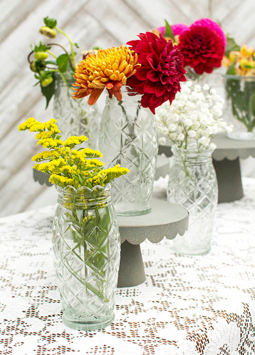 Brighten a table by adding colorful flowers to these vases! Create a more vintage design by adding our lace tablecloth and metal pedestals.