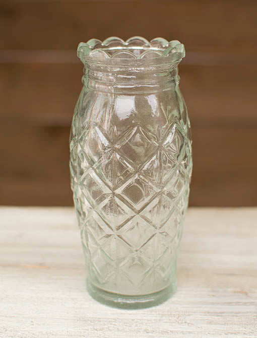 A diamond relief pattern circles around this clear glass vase for the perfect addition to your vintage or shabby styled event!