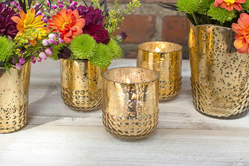 Each candle holder has a rustic hobnail detailed base that fits most votive and tea light candles.