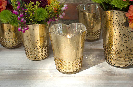 Each candle vessel has an elegant scalloped edge with a hobnail detailed base that fits most votive and tea light candles.