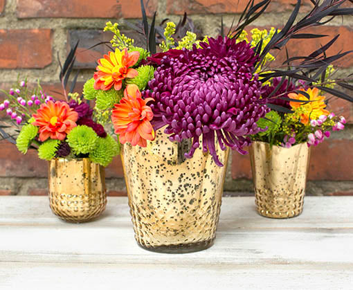 Three distinct sizes and styles of our mirrored gold mercury glass holders permit you to create delightful arrangements of flowers or glowing candles!