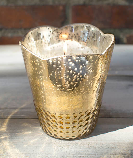 Beautiful light is plentiful, reflecting inside our scintillating gold vases.
