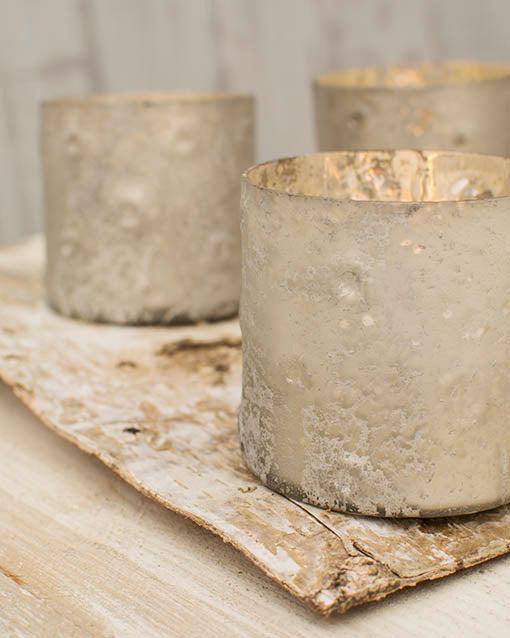 The extraordinary lunar texture of our matte silver votive holders is also reminiscent of the surface of birch bark, making it a sophisticated addition to your woodland or rustic themed event.