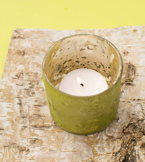 Choose between votive or tea lights to set these raku-style candle holders aglow!