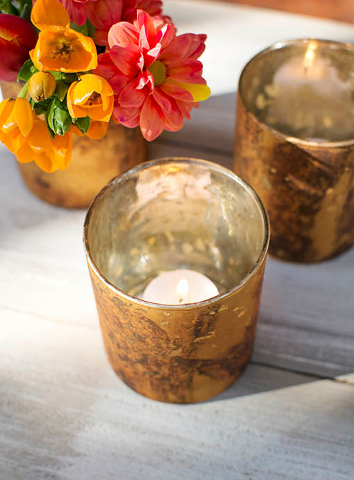 Illuminate an amber glow within the candle holder with our votive and tea light candles.