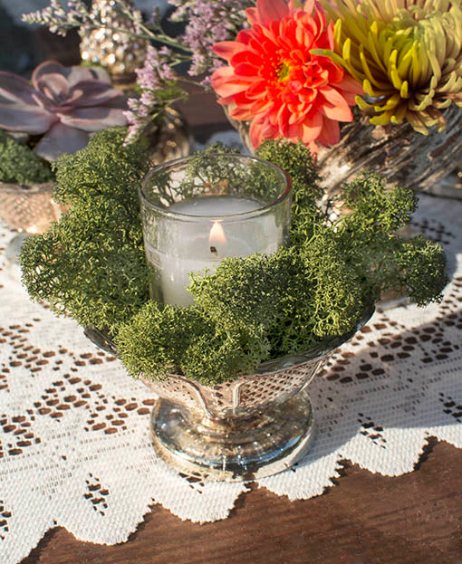 Nestle wax-filled glass votives into natural moss for a woodland or darkly romantic look, using our mercury glass bowls.
