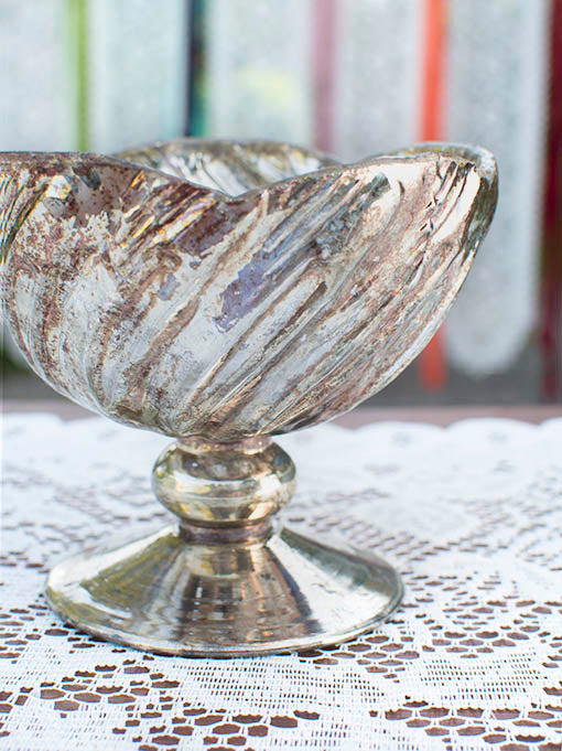 You'll love the vintage character of our patinated and silvered glass pedestaled compotes.