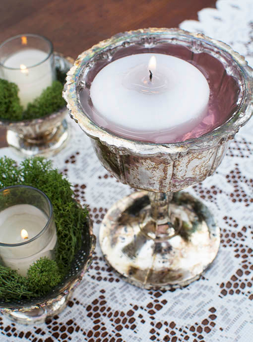 Try tinted water with floating candles to add hints of unexpected color to a jewel-tone setting, using our tarnished silver vintage-style mercury glass vessels.