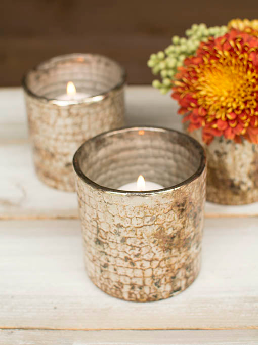 Fit small pillar candles, votive or tea light candles into these candle holders for rustic chic illumination.