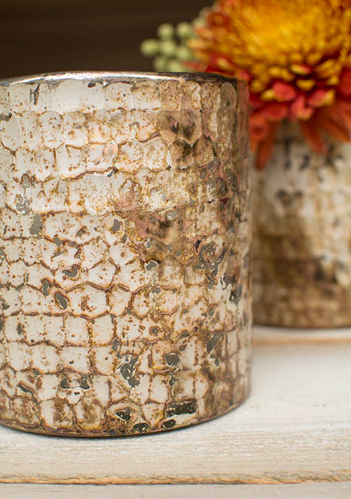 With a hammered texture and gold and bronze details, these candle holders easily fit into most themes and are the unique addition to any style.