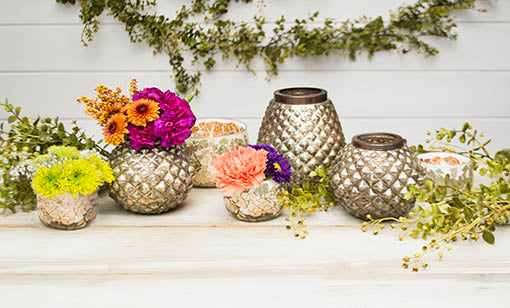 Add a variety of sizes of our mosaic glass candle holder with our mercury glass candle holders for completed tablescape.
