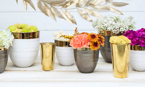 Combine glass candle holders with ceramic vases and to set an organic luxe table.