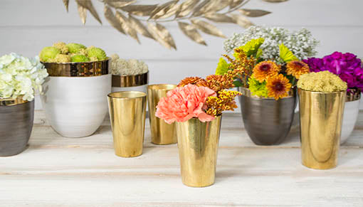 Fill these gilded vessels with light or with flora for a stunning tablescape! Ceramic vases sold separately.