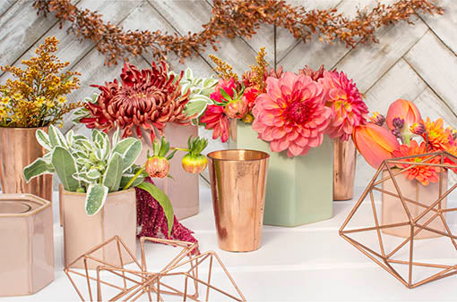 Mix and match our copper candle holders with a variety of our geometric decor for a modern tablescape.