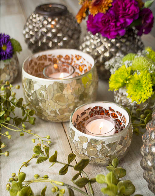 Candlelight reflects off the amber interior glass pieces of our mosaic candle holder