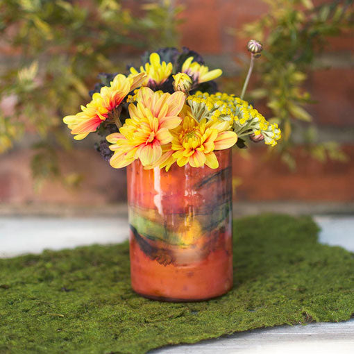 Stunning as a showcase for either flowers or luminous candles, our richly-hued, watercolor-inspired glass holders are a natural fit for an organic, foliage-rich decor.