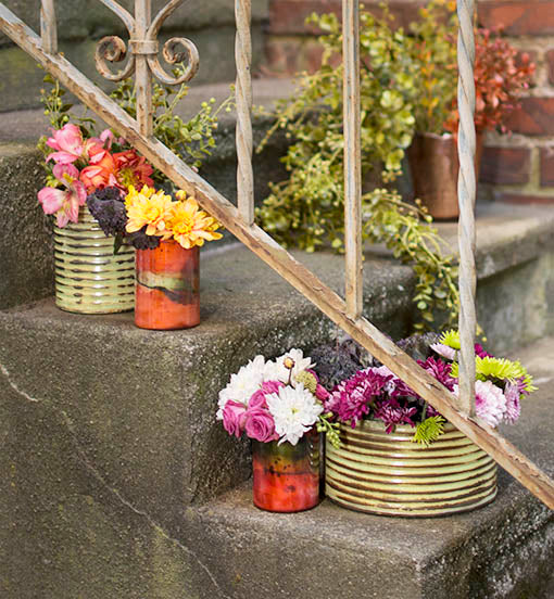 Classy or casual? Your call! Pair these lovely glass vases with rustic metal accessories to assemble a fetching garden display.