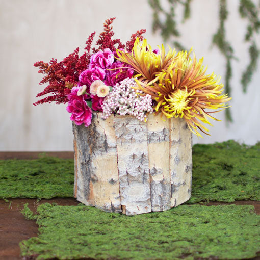With a plastic liner, easily reuse this natural wood vase over and over again.
