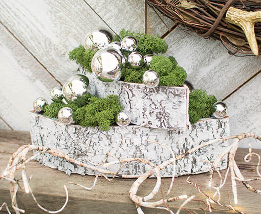 Combine with our large birch bark planter and fill with moss and glass floral picks for a new take on holiday decor. Add our lighted birch garland for a more enchanting tablescape.