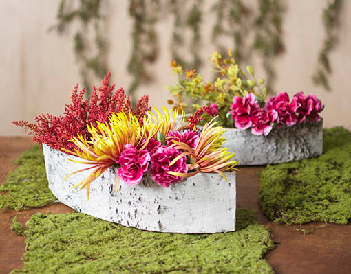 Decorate with floral bouquets and moss mats for the perfect springtime centerpiece!